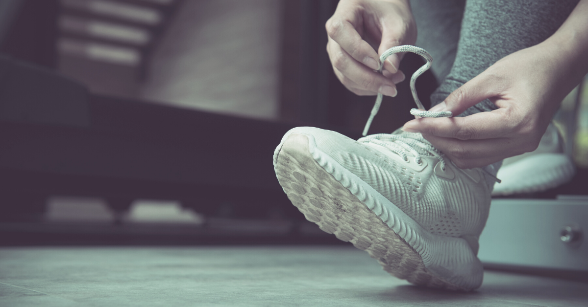 Lacing up running shoe for a workout