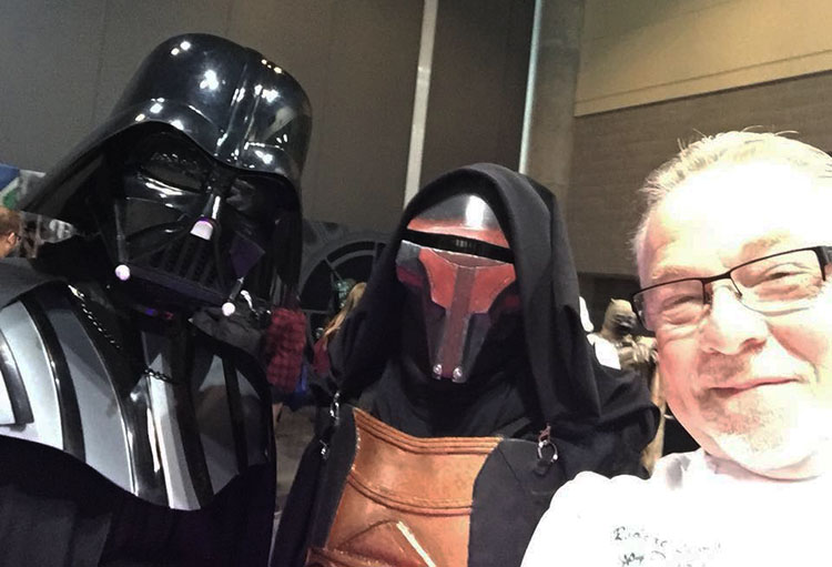 Chef Robert Lewis poses for a photo with Darth Vader