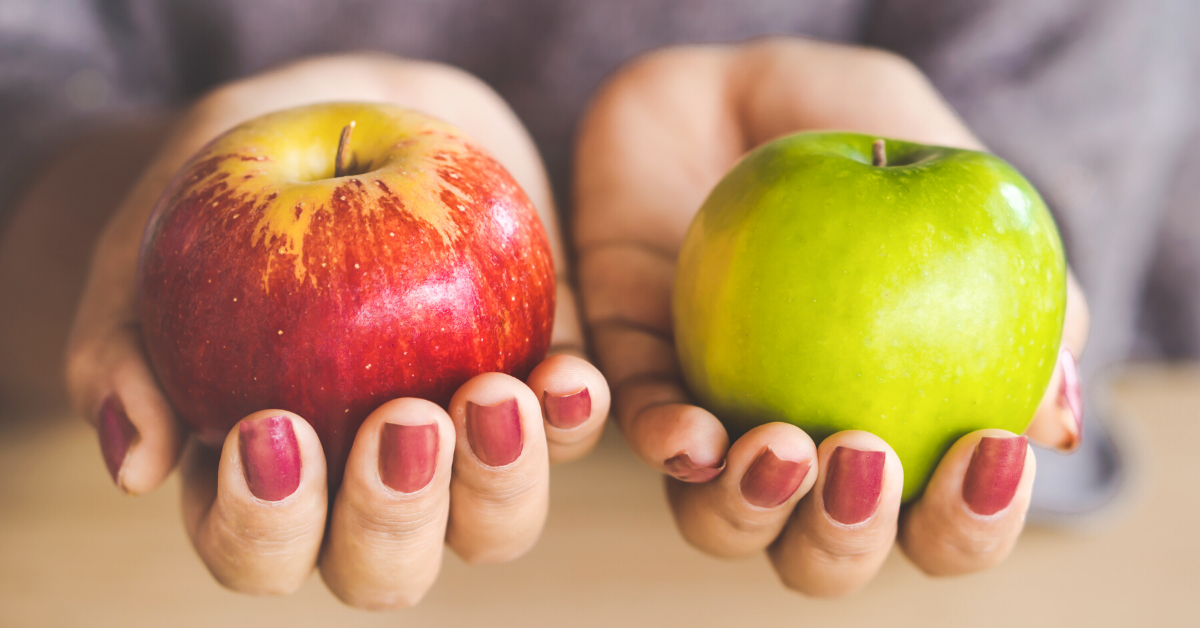 Comparing a red apple with a green apple