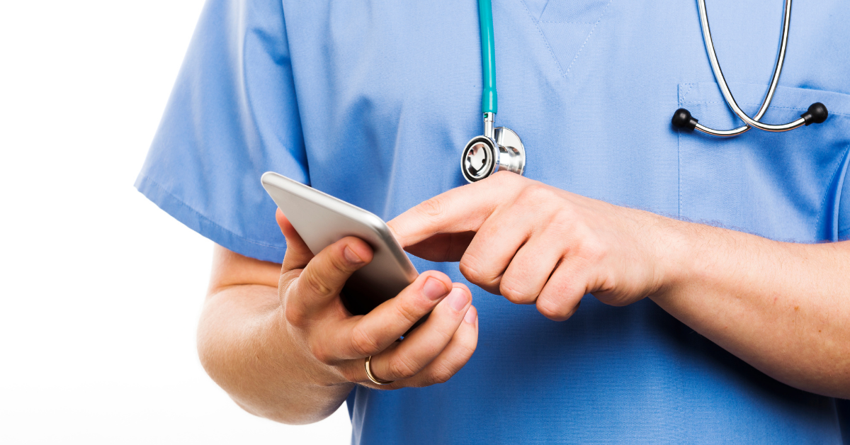 Doctor using at a smartphone