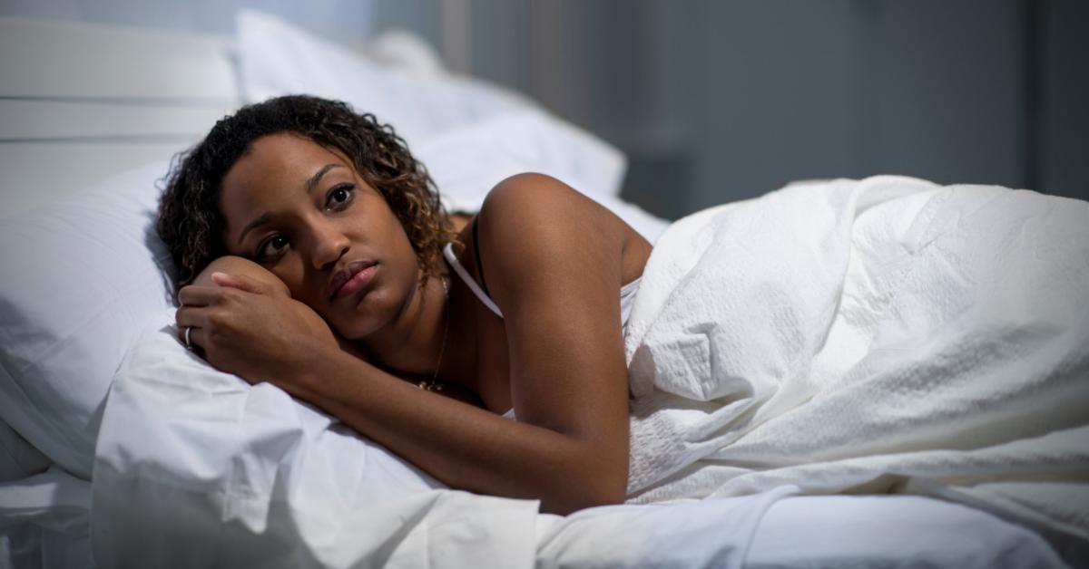 Woman lying awake in bed