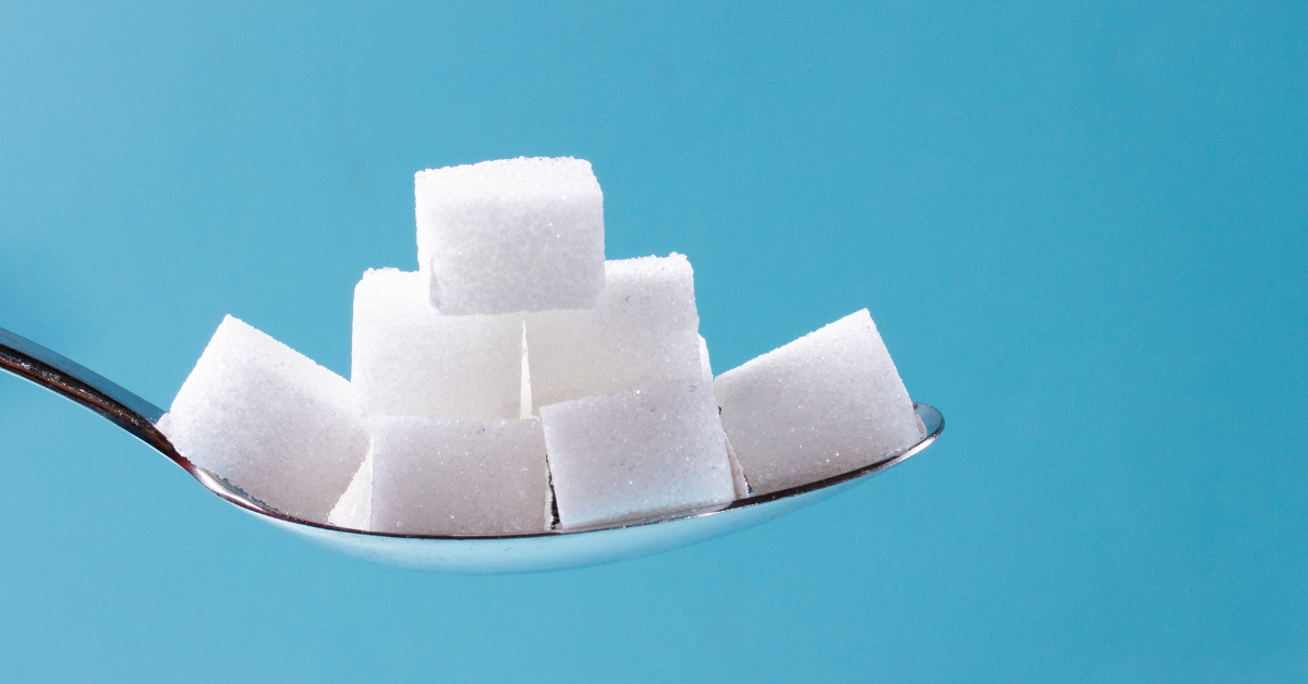 Spoon full of sugar cubes