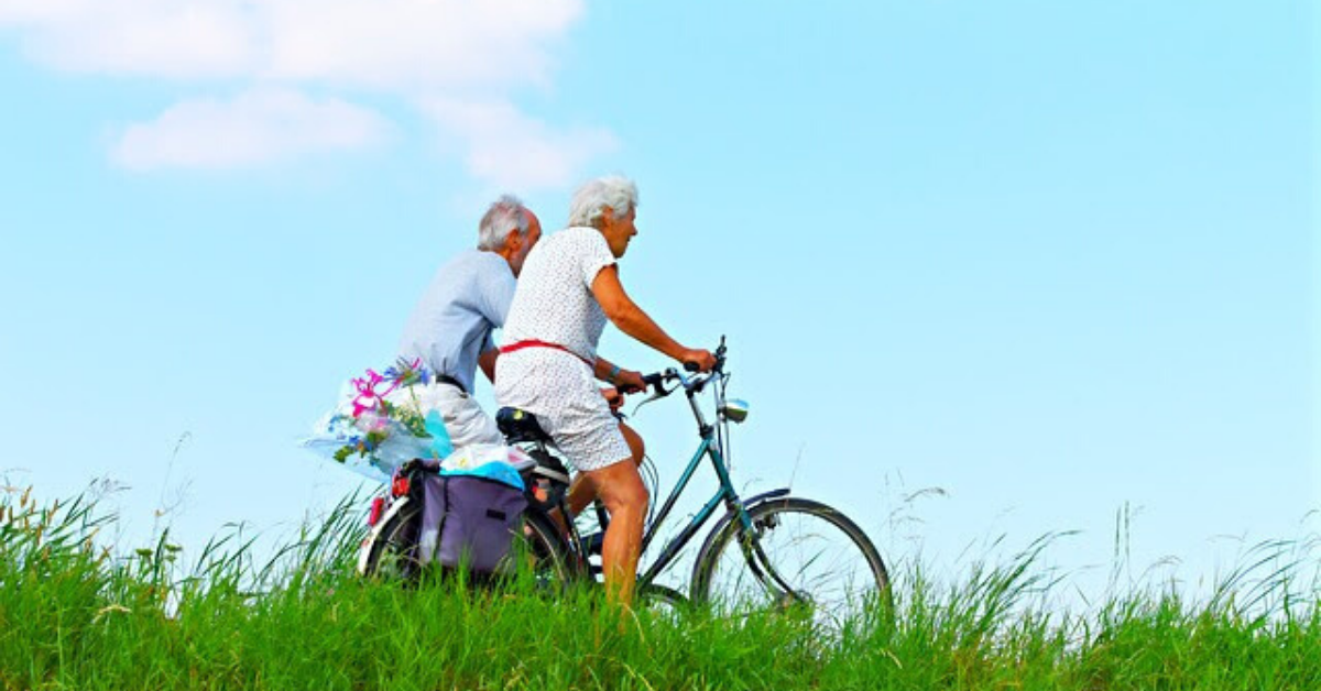 Older couple riding bicycles