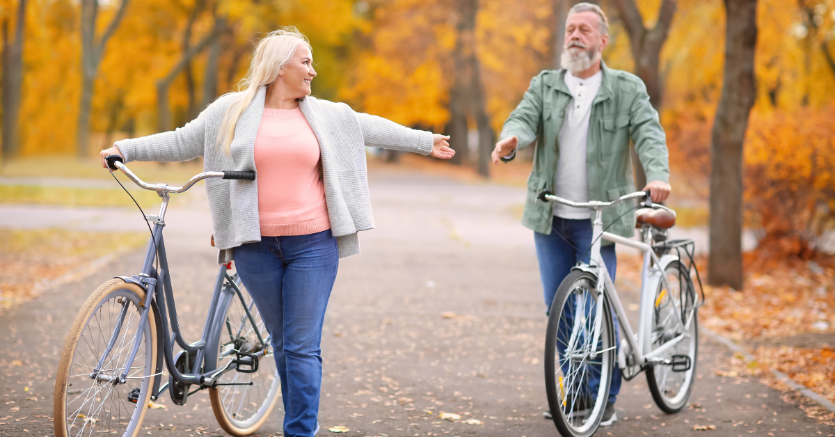 Two people walking with bicycles