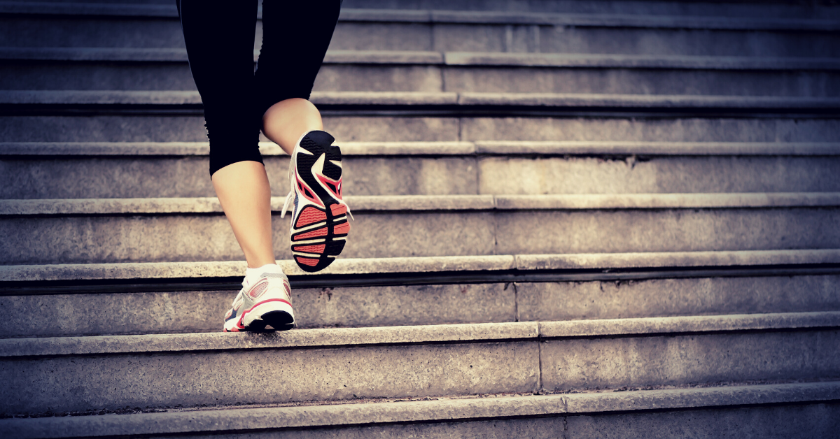Woman exercising on stairs