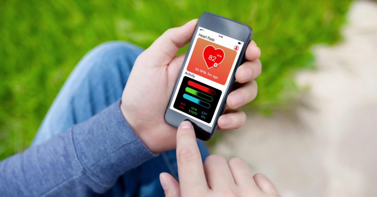 Smartphone in hand with health app open
