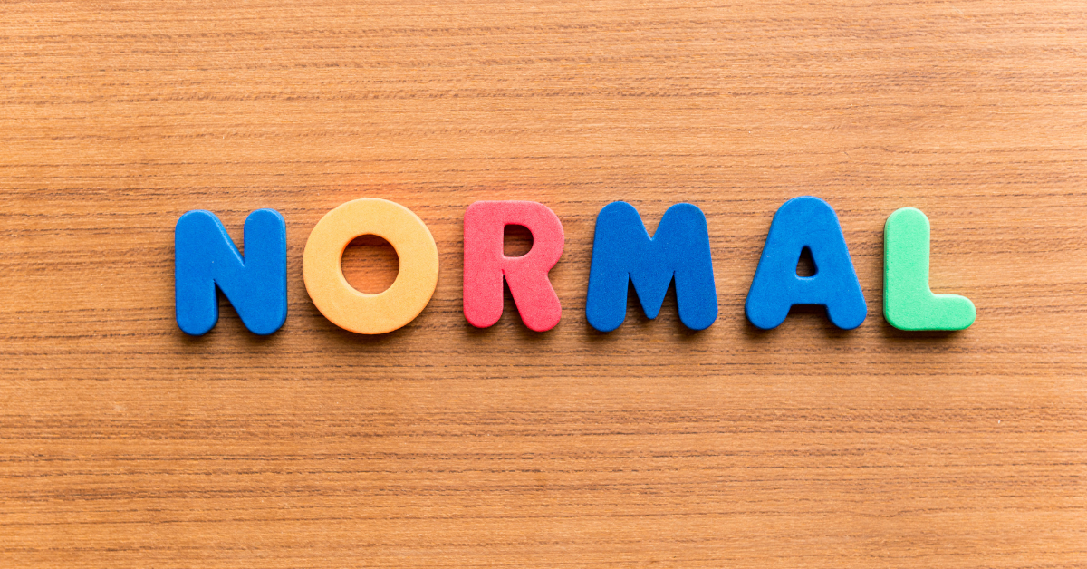 Letters on a wood surface: NORMAL