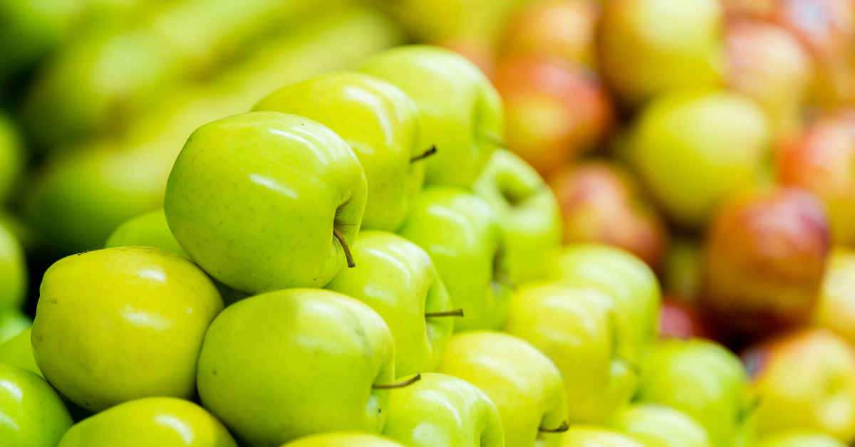Green and red apples stacked